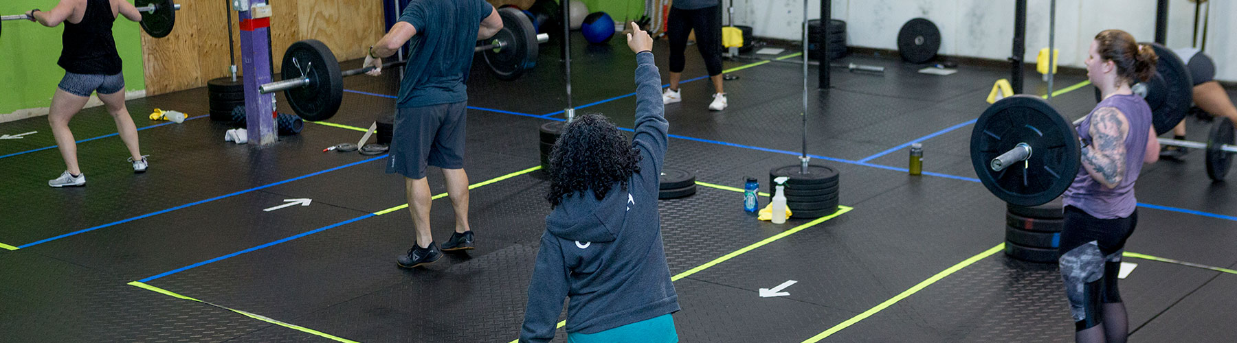 Coach leads CrossFit Iron Refined class in Eagle River Alaska with socially distanced boxes.