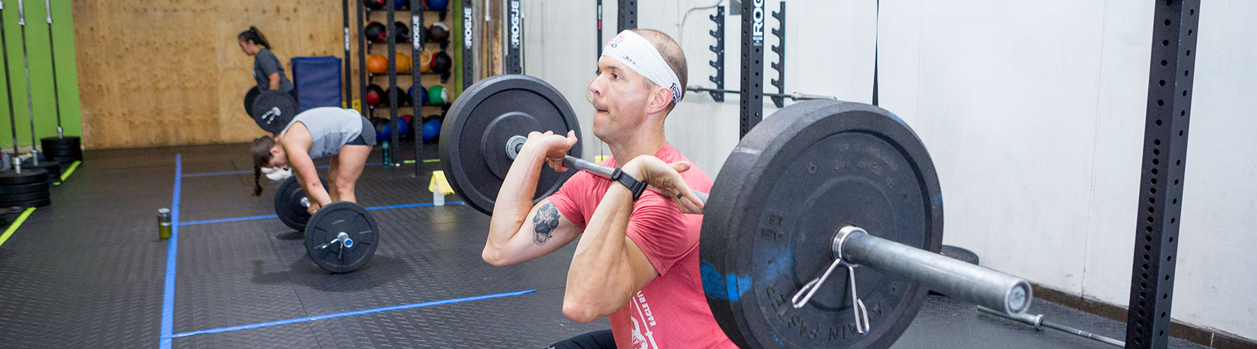 Man cleans weight at CrossFit Iron Refined in Eagle River Alaska