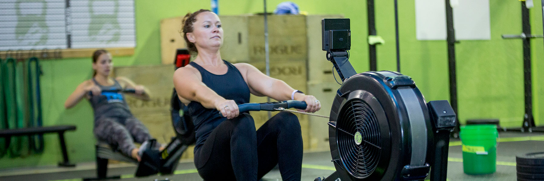 Woman rows at CrossFit Iron Refined in Eagle River Alaska