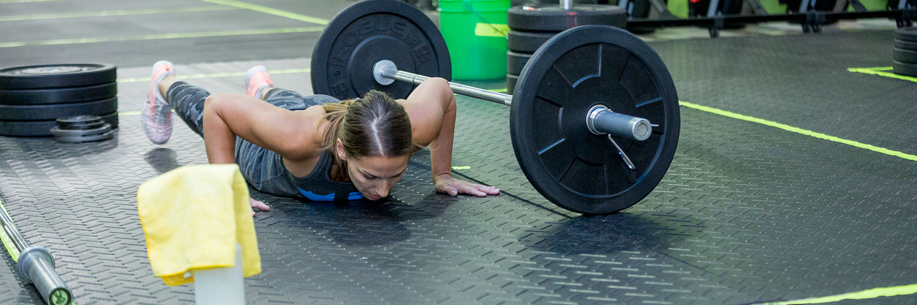 Woman does burpee at CrossFit Iron Refined in Eagle River Alaska