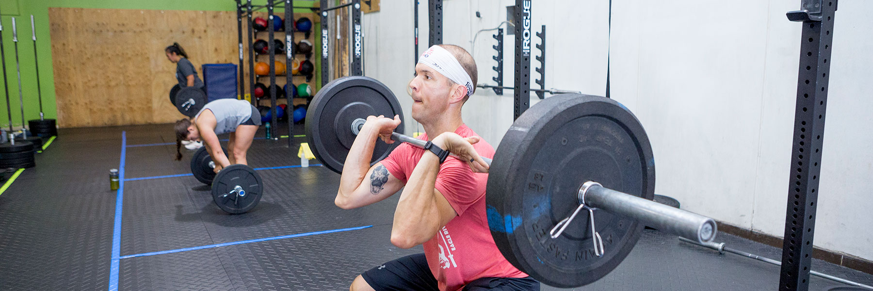 Class cleans barbells at CrossFit Iron Refined in Eagle River Alaska