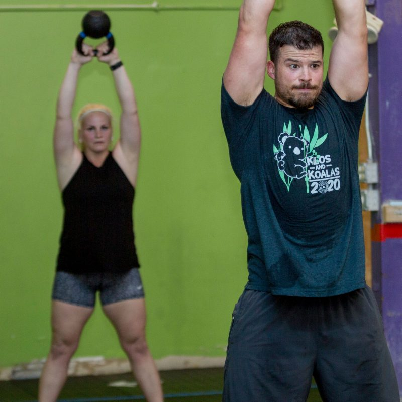 Athletes swing kettlebells at CrossFit Iron Refined in Eagle River Alaska